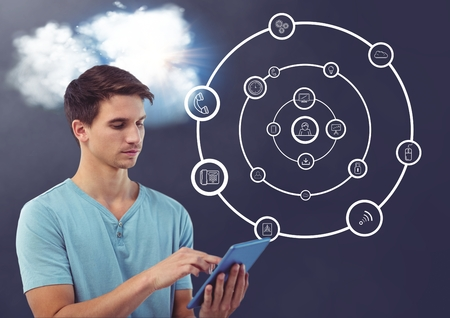 Digital composition of man using digital tablet with cloud and connecting icons in background photo