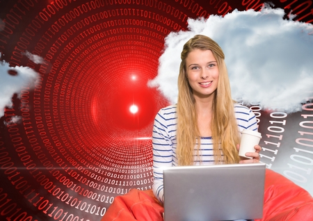 Digital composition of woman using laptop against binary background