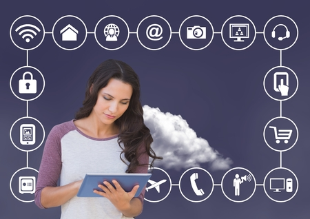 tablet pc in hand: Digital composition of woman using digital tablet with connecting icons and cloud in background