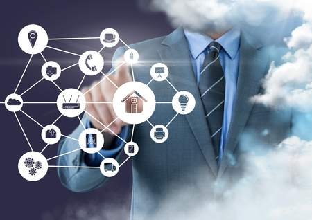 Digital composition of businessman touching applications interface against clouds
