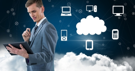smother: Digital composition of businessman using digital tablet against cloud computing concept in sky Stock Photo