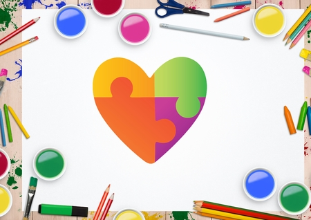 Digital composition of heart shape on white card against stationary items in background