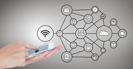 planos electricos: Composición digital de manos utilizando teléfono móvil y los iconos de conexión de red sobre fondo gris