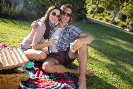 Happy couple having picnic in the park on a sunny day Stock Photo
