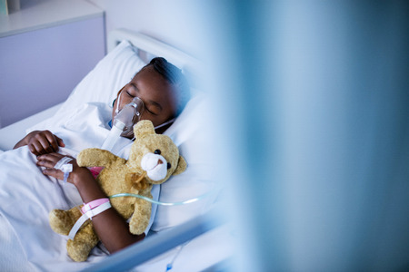Patient wearing oxygen mask while sleeping at hospital Stock Photo