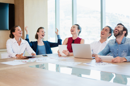 Smiling business executive having fun in conference room at office Stock Photo