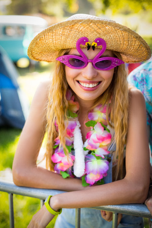 Portrait of beautiful woman in fancy sunglasses at park on a sunny day Stock Photo