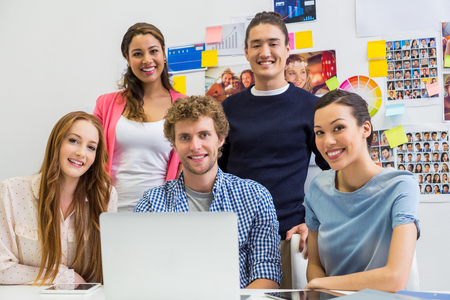 Portrait of smiling executives in office Stock Photo