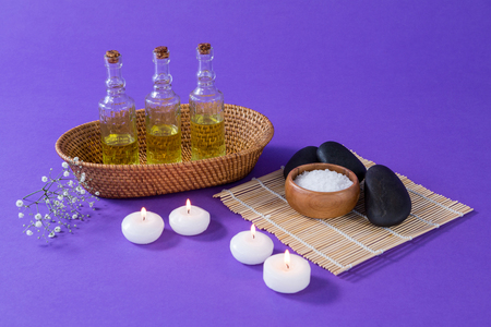 Set of spa accessories on purple background Stock Photo