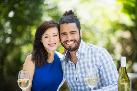 Portrait of happy couple enjoying together in a restaurant