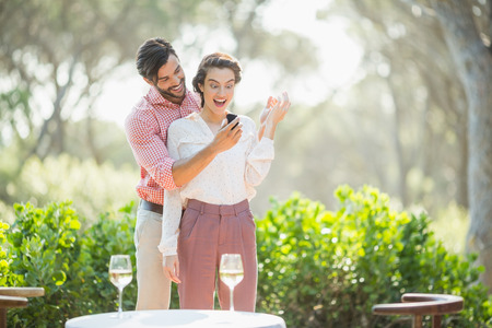 Man proposing a woman with a ring in the restaurant 版權商用圖片