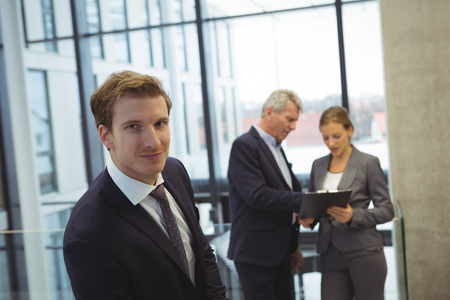 Portrait of businessman standing in the office Stock Photo