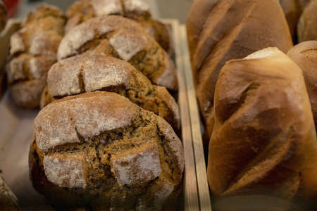 Einkorn bread and sourdough bread kept together at the bakery counter in the supermarket