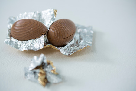 Close-up of chocolate Easter eggs on white background