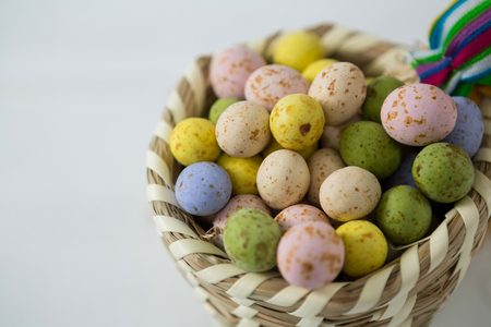 Close-up of colorful Easter eggs in wicker basket