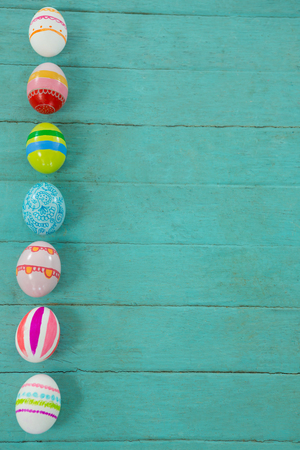 Close-up of painted Easter eggs on wooden plank