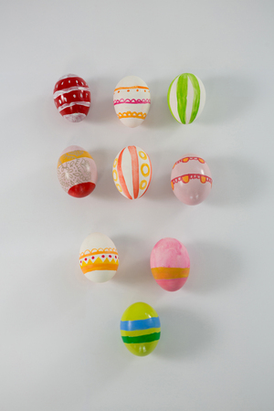 concern: Painted Easter eggs arranged on white background