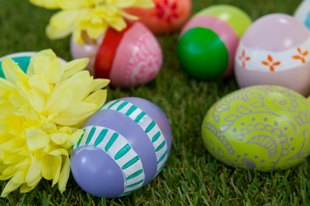 concern: Painted easter eggs with yellow flowers on grass Stock Photo