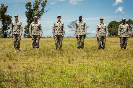 Group of military soldiers standing in line at boot camp