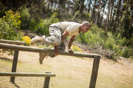 militant: Military soldier training on fitness trail at boot camp Stock Photo
