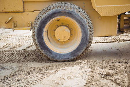 Close-up of the wheel of bulldozer at construction site