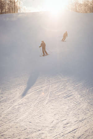 skiers: Two skiers skiing in snowy alps during winter
