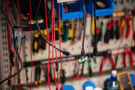 Various data cables hanging in a repair centre