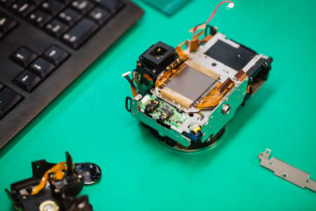 Close-up of mobile phone being repaired in a service centre LANG_EVOIMAGES