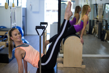 Woman exercising on wunda chair in gym