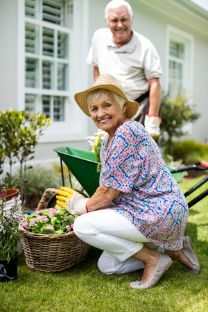 Senior couple gardening together in backyard Stock Photo