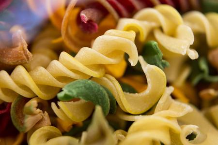 rotini: Close-up of multicolored rotini Stock Photo