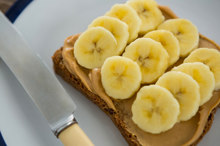 Close-up of sliced bananas spread on brown bread in plate