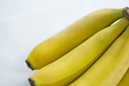 Close-up of fresh bunch of bananas on white background Stock Photo