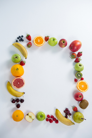halved  half: Various types of fruits arranged in square on white background