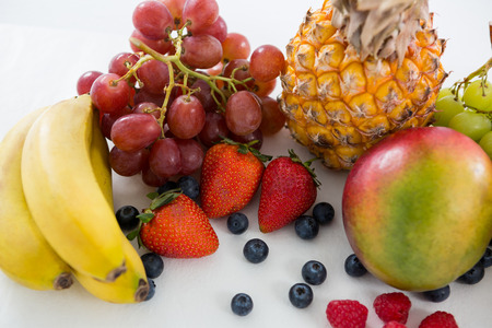 Close-up of various types of fruits on white background