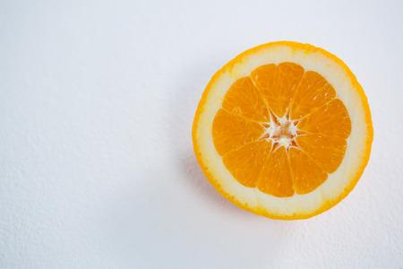 halved  half: Close-up of halved orange on white background