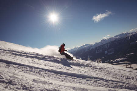 Skier skiing in snowy alps during winter