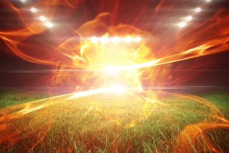 aplaudiendo: Pelota de fuego contra el campo de fútbol con luces brillantes 3d