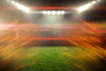 Ball of fire against illuminated soccer stadium 3d