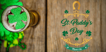 17th march: Print against shamrocks st patrick day and alcohol Stock Photo