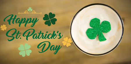 st  patrick's day: Print against st patricks day glass of beer with shamrock Stock Photo