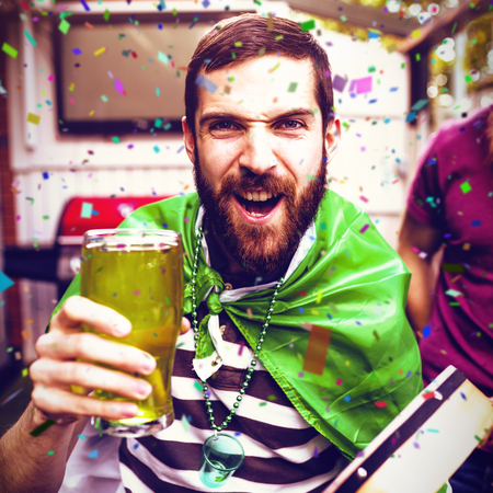 Flying colours against disguised man holding green pint 3d Stock Photo