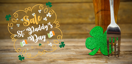 lucky charm: Print against beer glass with fork and shamrock for st patricks day Stock Photo