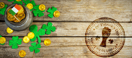 17th march: Composite image of St Patrick Day with beer glass symbol against composite image of shamrock, coins and irish flag