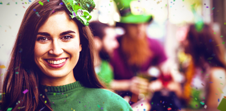 Flying colours against portrait of cheerful woman celebrating st patricks day 3d 스톡 콘텐츠