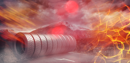 Digital image of black rubber tyre against landscape with stormy sky 3d Stock Photo