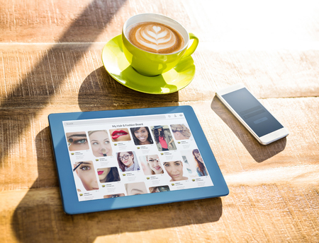 applauding: Composite image of website page blog against cup of coffee and tablet pc