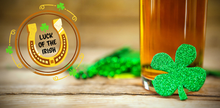 17th march: Composite image of St Patrick Day with horseshoe symbol against shamrocks st patrick day 3d
