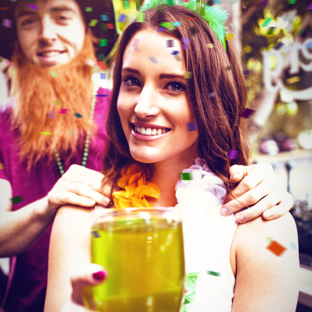 Flying colours against portrait of smiling woman holding green pint 3d