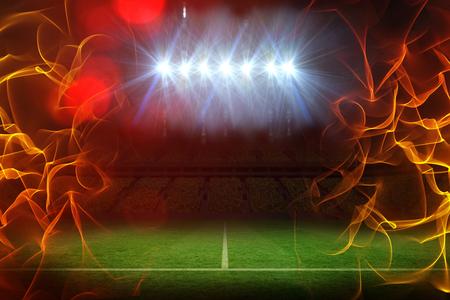Bola de fuego contra campo bajo focos iluminados 3d
